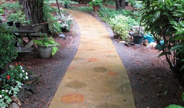 stamped concrete walkway to backyard