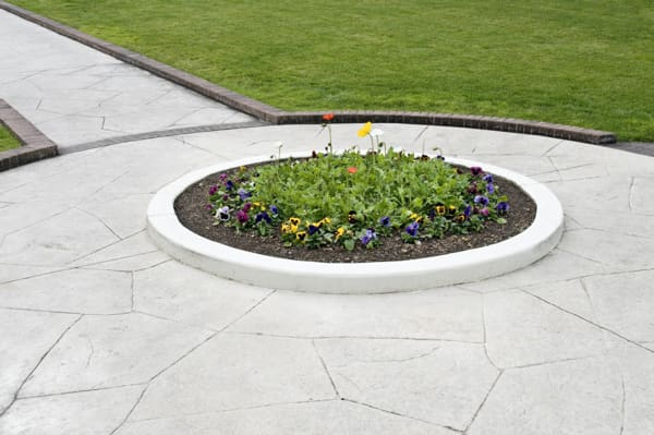 patterned concrete around a flower bed