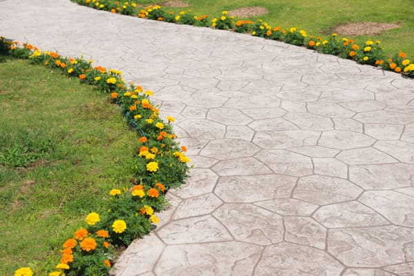 stamped concrete walkway with garden